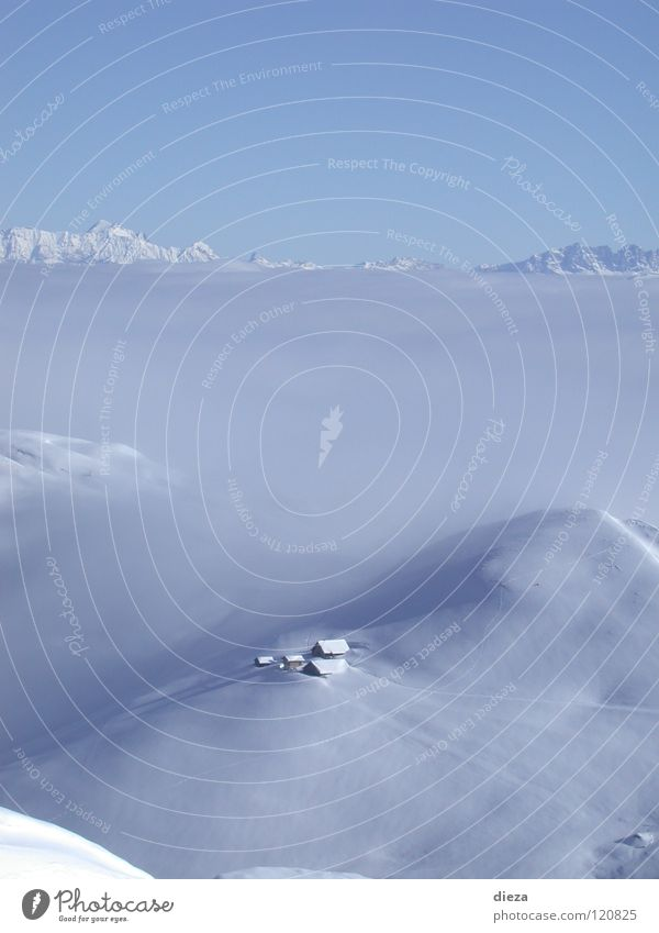 Himmelberg and foggy snow Sea of fog Winter Calm Loneliness Mountain Sky Snow trinity