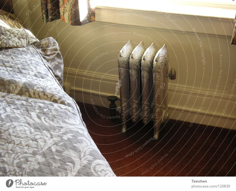 Radiators in Motel in San Francisco Heater Cast iron Hotel room Bed Living or residing Metal