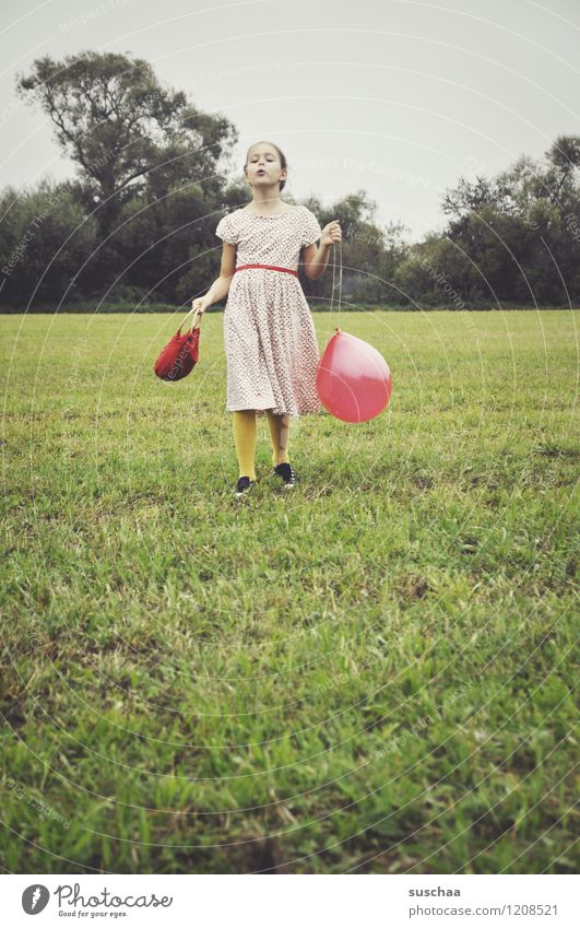 the red balloon . Child Girl Dress Bag Exterior shot Playing Meadow Grass Balloon Red Retro Self-confident Pride drama Dramatic art Actor young girl