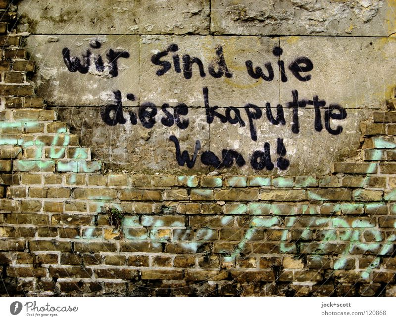 We're what? Smeared on a broken wall Subculture Street art Kreuzberg Wall (barrier) Brick Graffiti Word Dirty Hideous Broken Trashy Fear of the future Mistrust