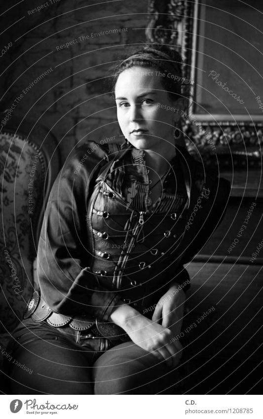 Portrait from another time Young woman Youth (Young adults) 18 - 30 years Adults Pants Blouse Corsage Chignon Sit Dark Historic Black White Past