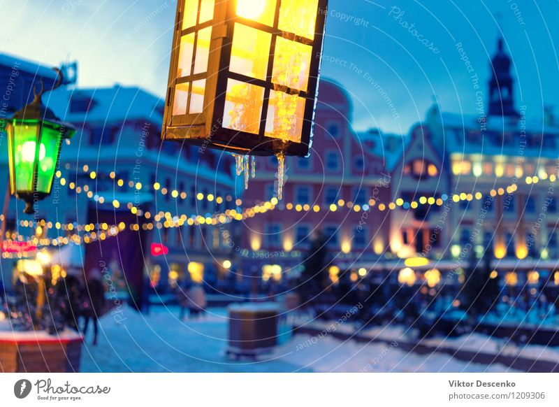 Yellow and green lights on the background of the old town Sky City Old Blue Beautiful Colour White Red Winter Dark Street Architecture Building Art Lamp