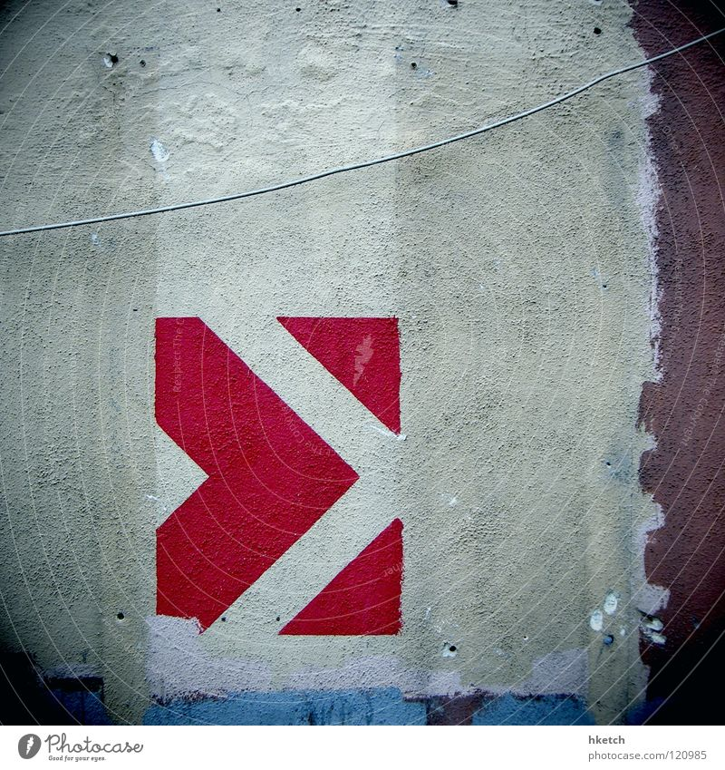 Please continue Wall (building) Direction Right Future Red White Voyeuristic Curiosity Going Predict Interpret Warning label Warning sign Detail Dangerous Arrow