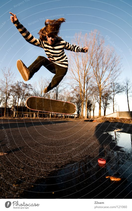 360 Flip II Moody Action Skateboarding Contentment Kickflip Salto Jump Striped Tar Concrete Tree Wide angle Youth (Young adults) Sports Puddle Reflection Speed