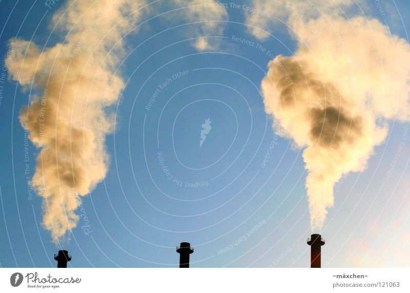 Sky Sun Blue Clouds Yellow Far-off places Dark Bright Brown Orange Dirty Industry Aviation Tower Smoke Chimney
