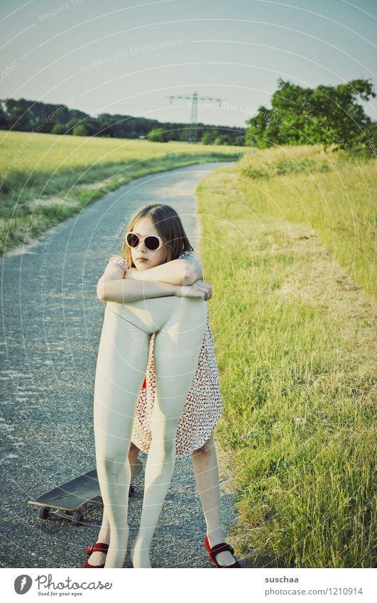 rest Nature Exterior shot Summer Lanes & trails Grass Child Girl Dress Sunglasses Mannequin Legs Abdomen Lift Carrying Infancy upbringing Whimsical Strange