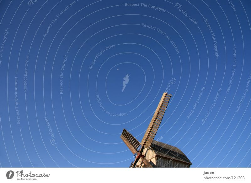 Flight into the blue Windmill Mill Wood Sky blue Azure blue Propeller Old Blue Beautiful weather mill club Bright background Isolated Image Copy Space top