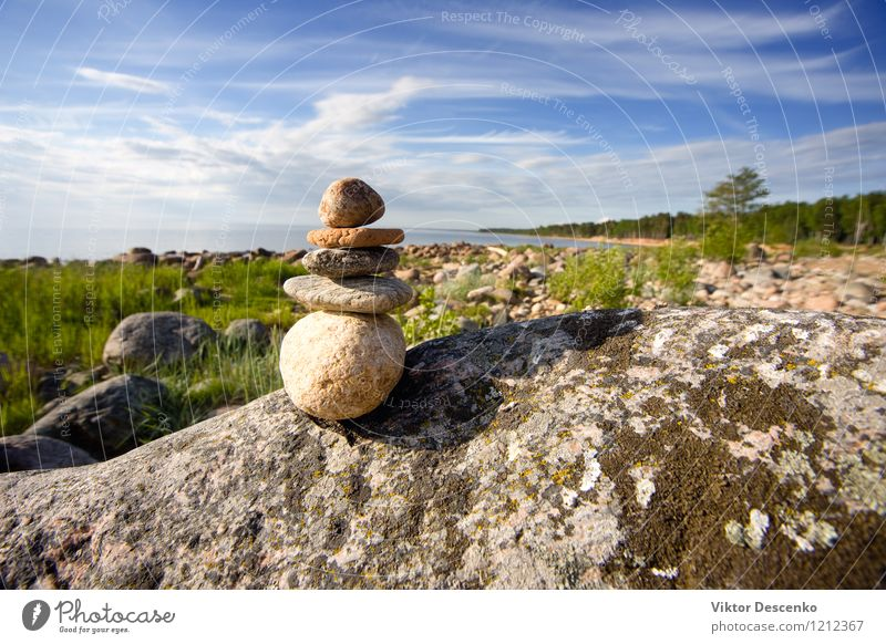 Rocks by the sea on one another pyramid Meditation Summer Beach Ocean Yoga Nature Sky Coast Stone White Peace Accumulation Pebble tower Zen Stack stability