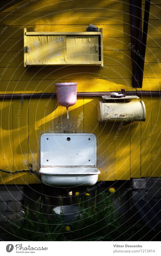 Pink washbasin on the yellow wall of old country house Style Design House (Residential Structure) Furniture Bathroom Metal Dirty Green Black White Sink faucet