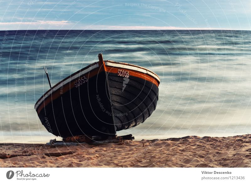 Wooden boat on the sandy shore Summer Beach Ocean Landscape Sand Sky Baltic Sea Rowboat Watercraft Old Brown Tradition wooden fishing water Rustic