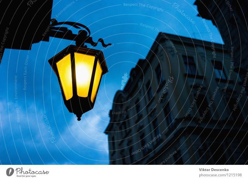 City street light yellow against the blue sky Sky Blue White Black Yellow Street Architecture Lamp Metal Design Decoration Energy Historic Lantern Vertical