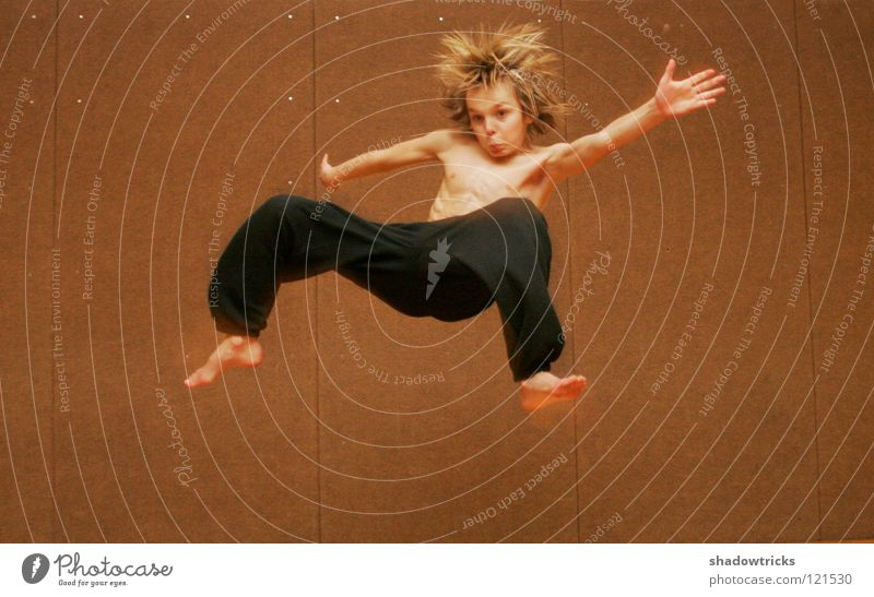 Human being Sports Boy (child) Hair and hairstyles Jump Style Body Child Creepy Pants Athletic Evil Flexible Musculature Combat sports Martial arts