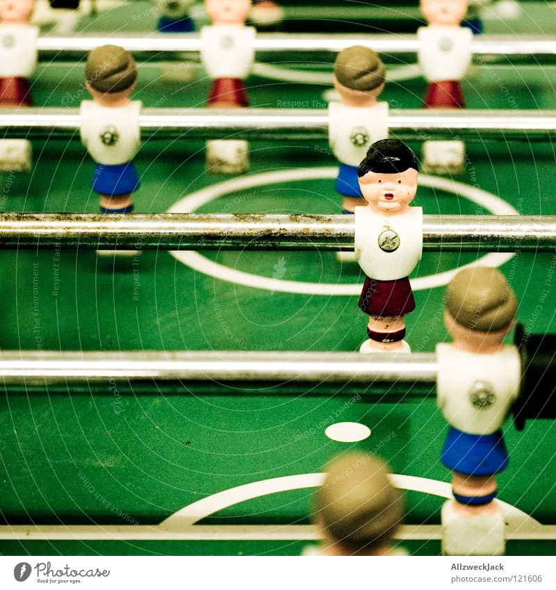 11 accomplices Playing Table Rod Green Break Friendship Joy Sports Ball sports Soccer player Table soccer Shallow depth of field Colour photo Screwed on tight