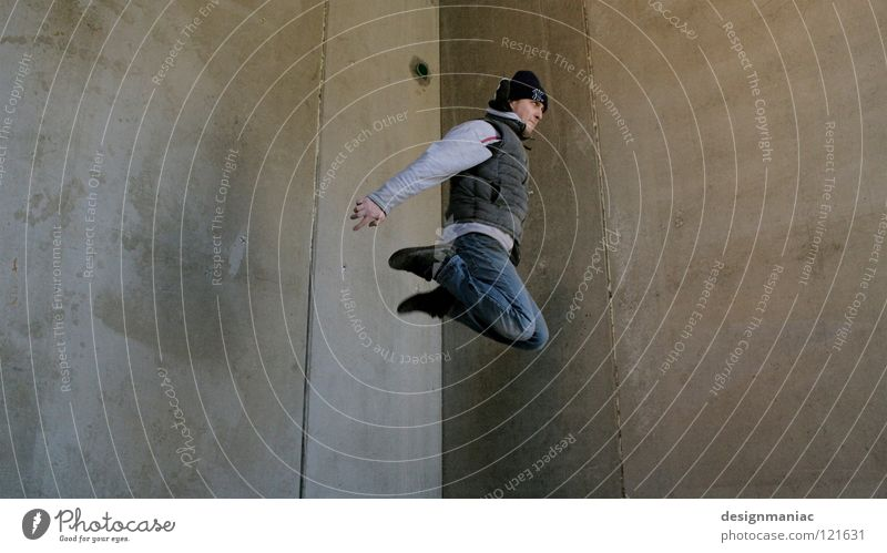 urban freestyle Parkour Concrete Wall (building) Man Cap Gray Drainage Jump Hover Winter Cold Dirty Vest Knee Empty Weightlessness Ghetto Freestyle