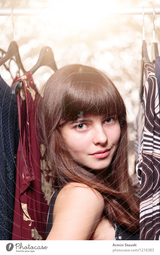 Teen with clothes on the clothes rail Lifestyle Shopping Luxury Elegant Style Design pretty Hair and hairstyles Face Harmonious Human being Feminine Young woman