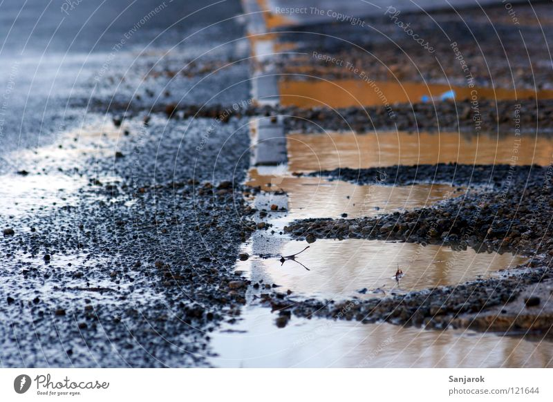 After the rain falls Puddle Roadside Tar Edge Reflection Gravel Gray Traffic infrastructure Water Rain Dirty Street Floor covering Stone Deserted Detail