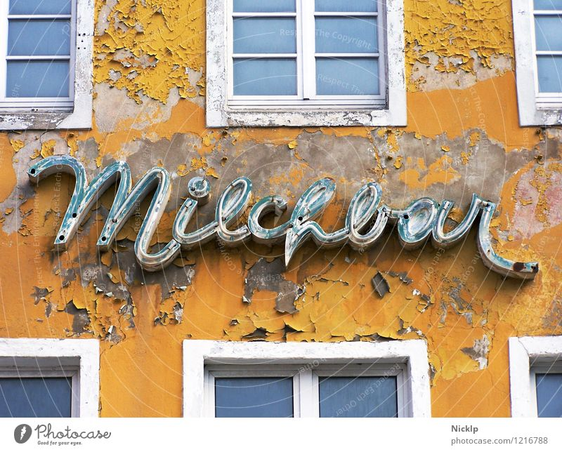 old decayed neon sign of the Milchbar in Stralsund, Germany Milk bar Neon sign Typography Characters Signs and labeling Old Decline Past Yellow-orange White
