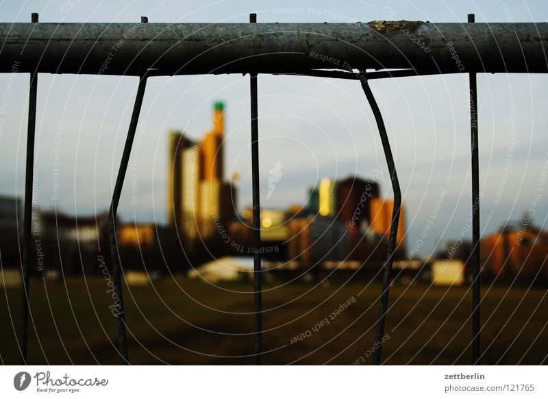 Potsdamer Platz behind golf course Middle Landmark Golf course Fence Metalware Wire fence Grating Barrier Blur House (Residential Structure) High-rise
