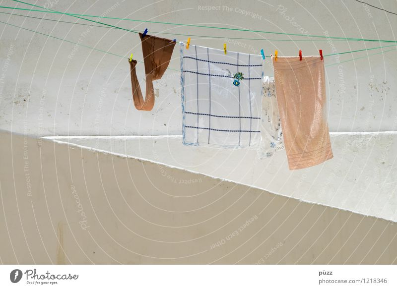 washing day Living or residing Flat (apartment) Village Deserted House (Residential Structure) Wall (barrier) Wall (building) Facade Clothing Tights Stone Wet