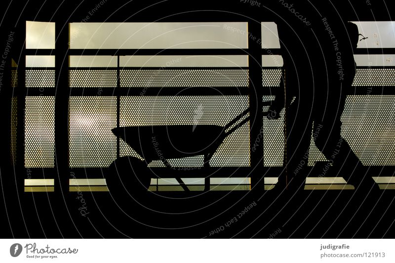 700 A wheelbarrow full of pictures. Wheelbarrow Working man Man Work and employment Construction site Fence Barrier Driving Silhouette Dark Black Back-light
