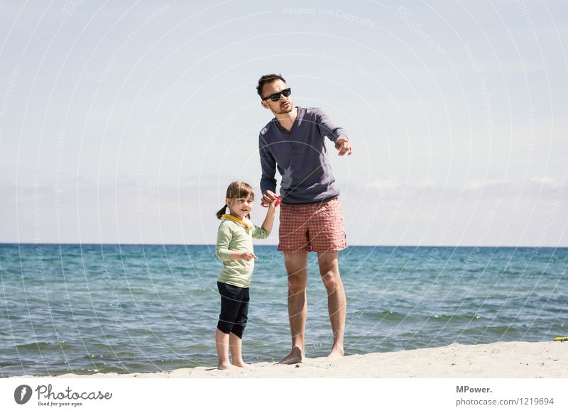 two kite tamer Human being Masculine Feminine Girl Man Adults Parents Family & Relations Infancy Life 2 Environment Sand Sky Horizon Sun Wind Waves Coast Beach