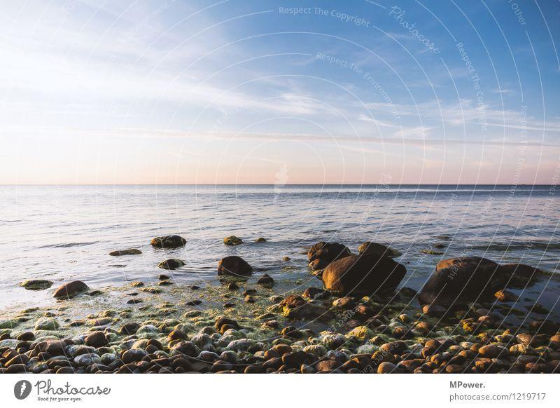 Sky Blue Summer Water White Ocean Clouds Far-off places Beach Environment Coast Stone Moody Rock Horizon Orange