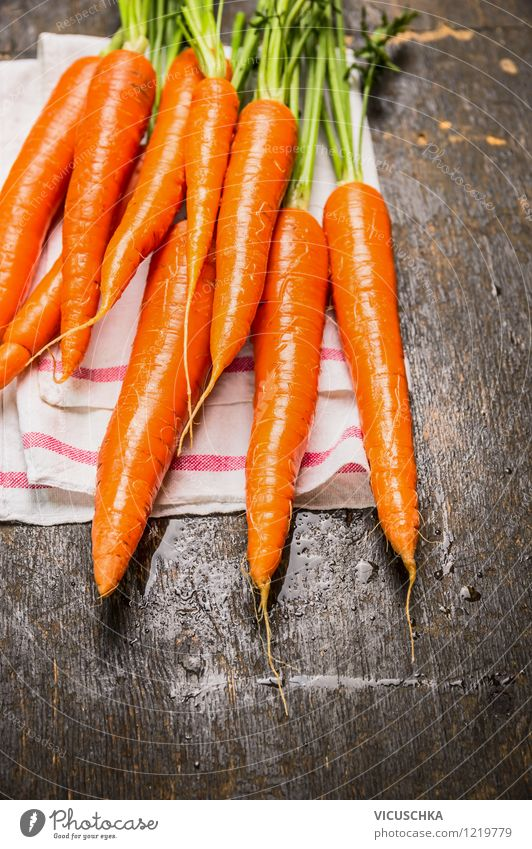 Fresh carrots Food Vegetable Nutrition Organic produce Vegetarian diet Diet Style Design Healthy Eating Life Garden Table Snack Vitamin Carrot garden vegetables