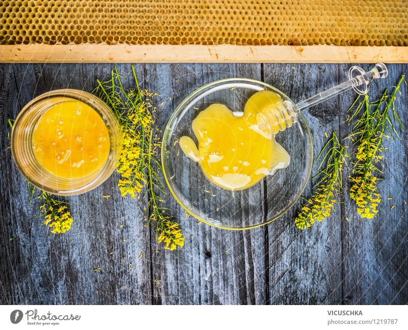 Rapeseed honey with fresh flowering plant and honeycomb Food Dessert Candy Nutrition Organic produce Vegetarian diet Diet Plate Bowl Glass Spoon Style Design