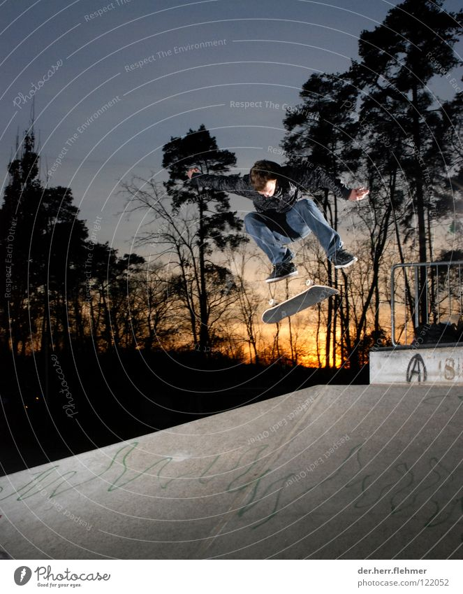 kickflip Skateboard Sports ground Speyer Sunset Light Concrete Tree Jacket Playing Shadow rail Jeans Axle Parking level