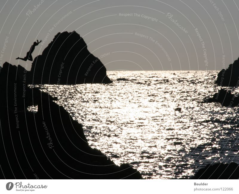 jump Jump Ocean Dusk Cliff Sunset Leisure and hobbies Rock Water Nature
