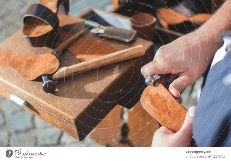 Hands making shoes Handicraft Work and employment Craft (trade) Tool Human being Man Adults Leather Footwear Old Make Tradition Shoemaker workshop skill
