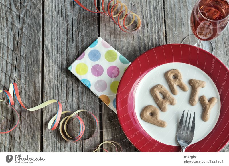 The letters PARTY on a plate with napkin, champagne glass and streamers Nutrition Beverage Cold drink Sparkling wine Prosecco Crockery Plate Glass