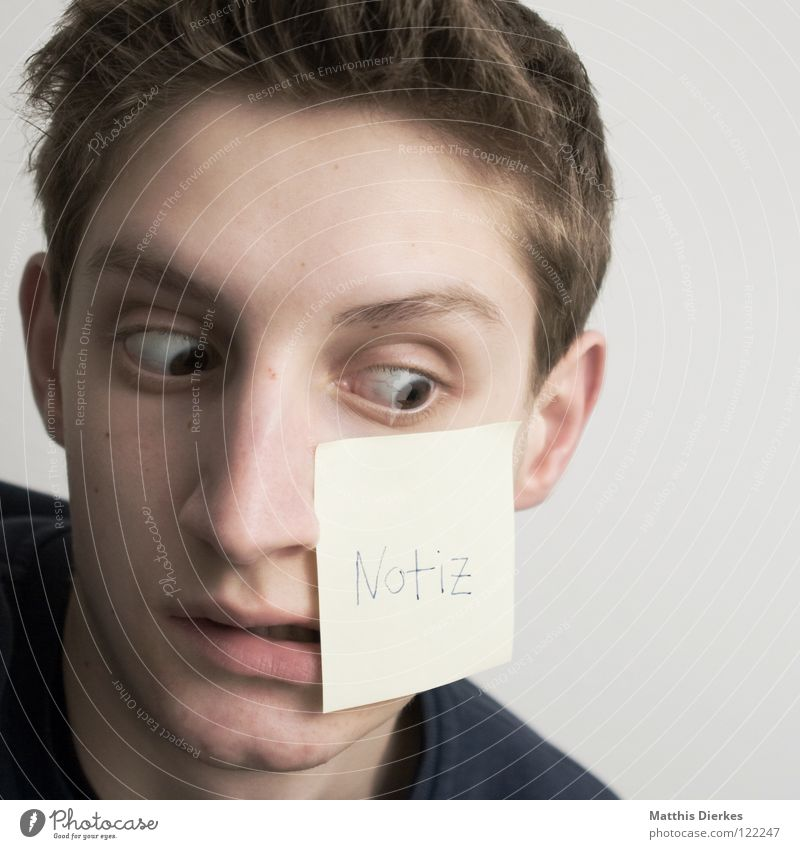 oblivious Youth (Young adults) Surprise Amazed Squint Piece of paper Write Forget Portrait photograph Adhesive Letters (alphabet) Word Typography Notebook