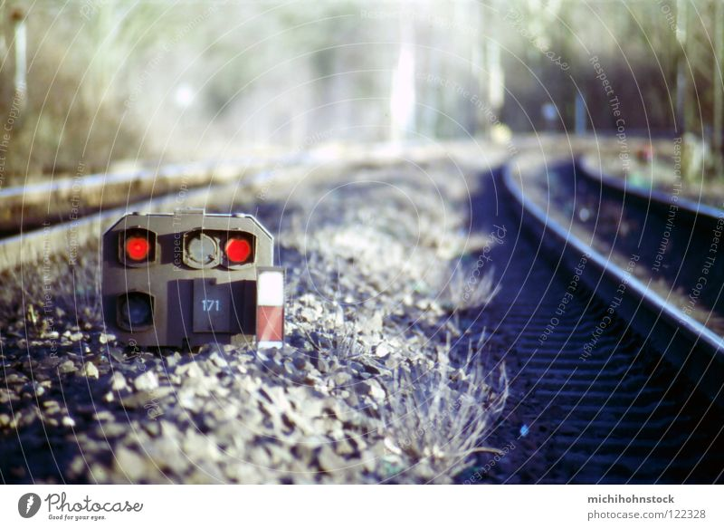 the train is coming... Railroad tracks Traffic infrastructure Slide Analog Gravel Red Traffic light Engine driver Transport Signal Switch depth blur