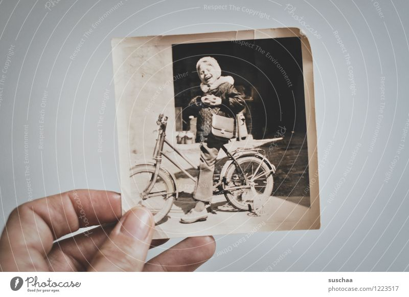 old black and white photo of a child on a bicycle with support wheels Photography Analog Old Black & white photo Hand Child Bicycle Tricycle Memory Infancy Past
