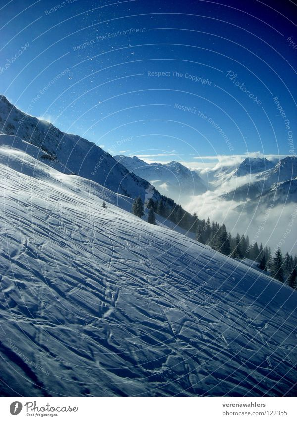 Downhill value. White Skiing Winter Mountain Snow Tracks Alps Blue Valley Sky Vantage point Far-off places