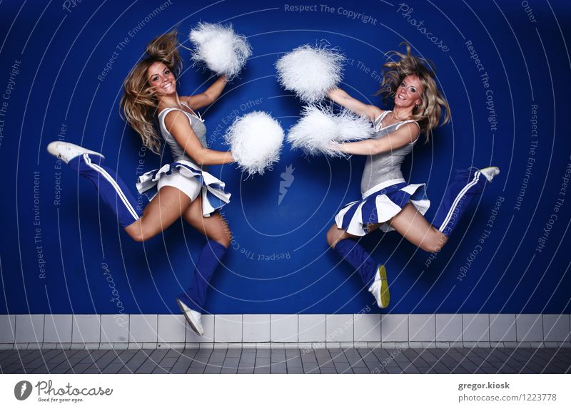 Jump Around Cheerleaders Joy Hair and hairstyles Athletic Feasts & Celebrations Sports Ball sports Sports team Sporting event Stadium Professional training