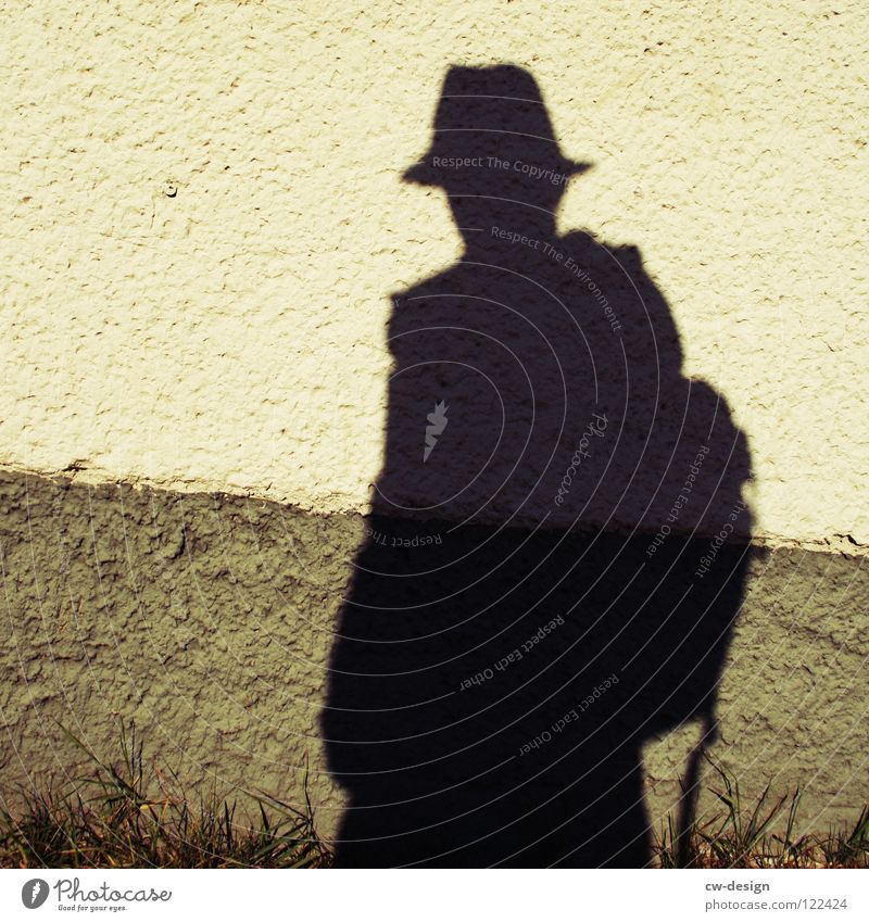 He's got a shadow. Cap Posture To go for a walk Commuter Air Breathe Man Masculine Minimalistic Where Territory Photo shoot Media Photographer Take a photo
