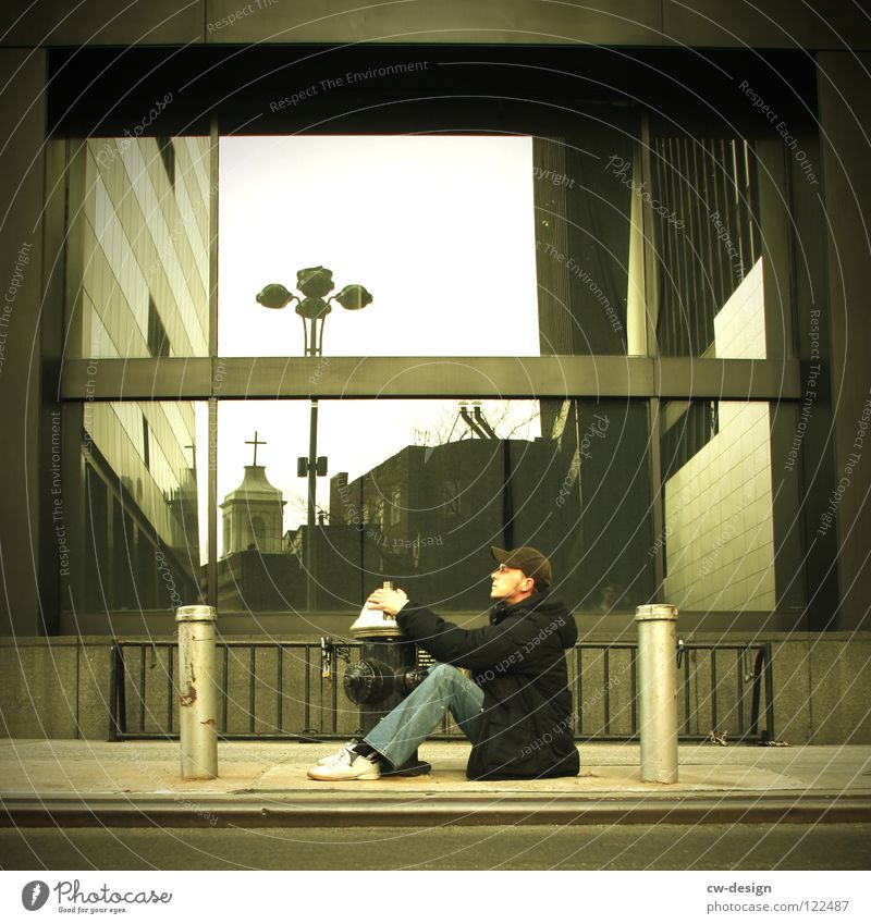 A L L E S W A S E I N G U T E S P H O T O .... SECOND New York City Young man Sit Sidewalk Fire hydrant Bollard Modern architecture Architect Window pane