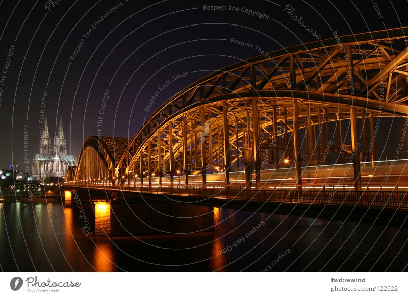 Cologne at night Long exposure Night Light Railroad House of worship Bridge Night shot Dome cathedral architecture train