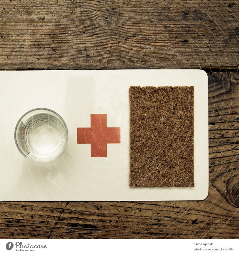 Water & Bread Crucifix Table Texture of wood First Aid Red Dish towel Kitchen Crispbread Black bread Chopping board Appetite Drinking Glass Tumbler Help Poverty