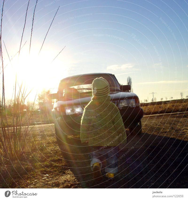 Sky Sun Joy Winter Cold Boy (child) Meadow Car Landscape Field Horizon Electricity Dangerous Threat Construction site Trash