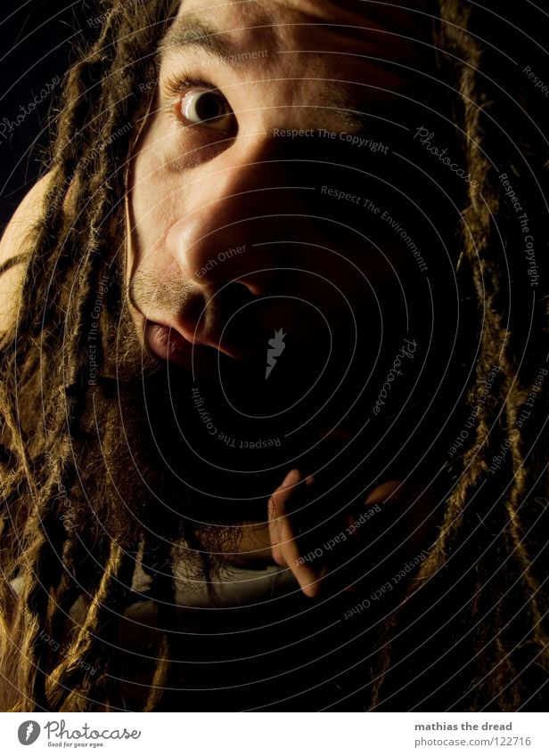 view Dreadlocks Felt Long Dark Upper body Man Masculine Concealed Facial hair Beard hair Unshaven Light Visual spectacle Shadow play Pants Chin Abrupt