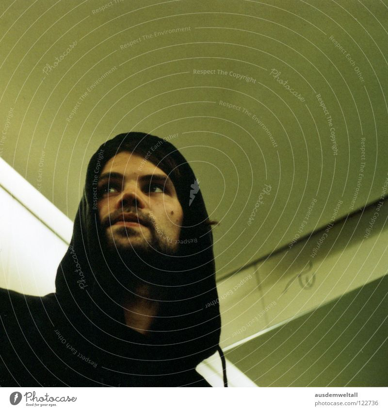 rope Masculine Man Portrait photograph Hooded (clothing) Black Facial hair Elevator Green Beige Analog Human being Emotions Looking Calm 50mm Scan Interior shot