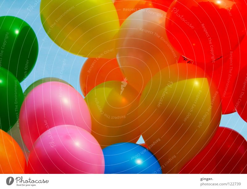 Colourful air kisses at carnival Joy Decoration Feasts & Celebrations Carnival Sky Wind Balloon Blue Yellow Green Orange Pink Red Muddled Hover Judder Mix