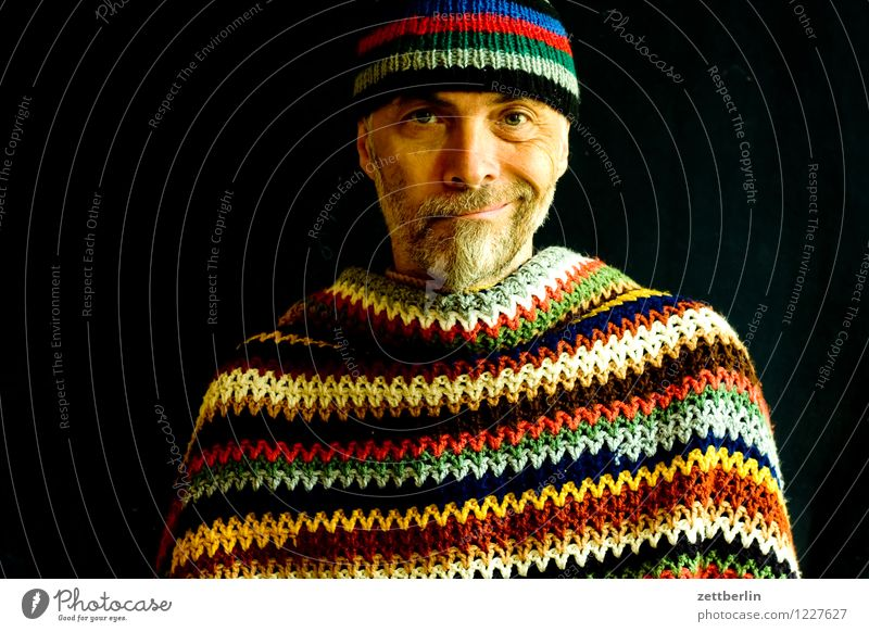 Man with knitted wool cap and crocheted wool blanket Human being Adults Senior citizen portrait Face Multicoloured Pattern Knitted Crocheted Stripe Cape Sweater