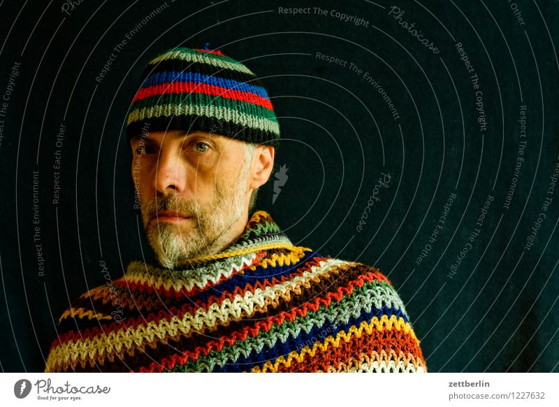 Knitting and crochet - man with knitted cap and crocheted poncho portrait Human being Man Face Eyes Nose Mouth Looking into the camera Face to face Adults