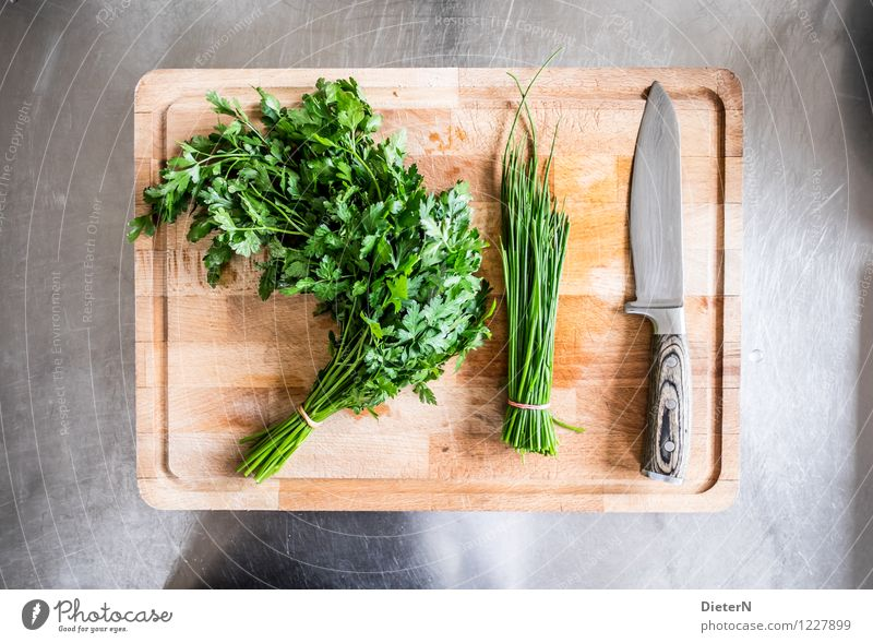 It's served Food Herbs and spices Organic produce Crockery Knives Brown Green Silver Chives Parsley Blade Chopping board Wooden board Steel Kitchen equipment