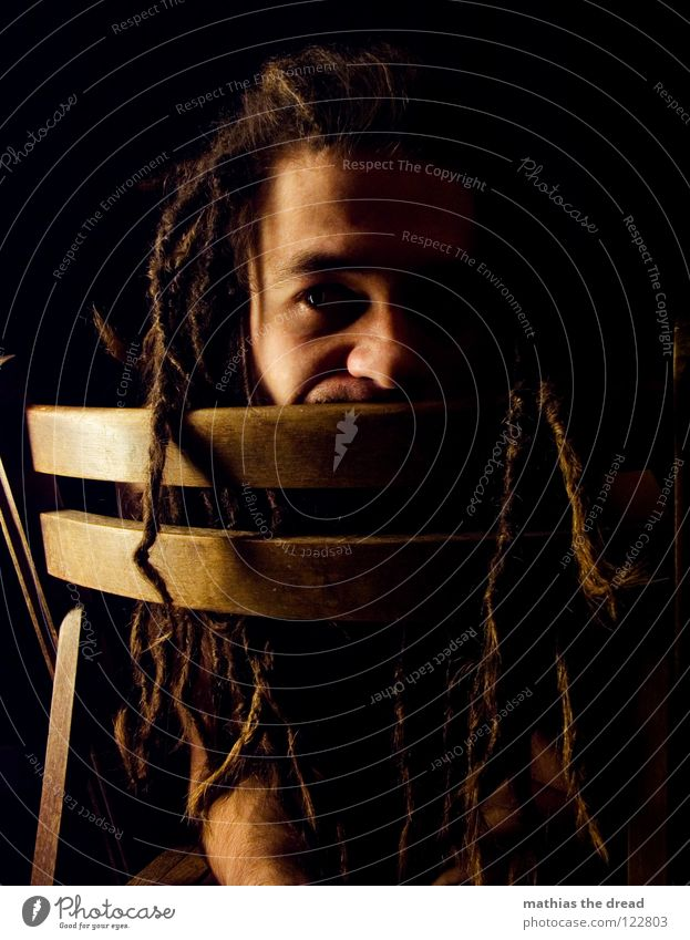 No. 19 Dreadlocks Felt Long Dark Upper body Man Masculine Concealed Facial hair Beard hair Unshaven Visual spectacle Shadow play Pants Chin Black Curiosity