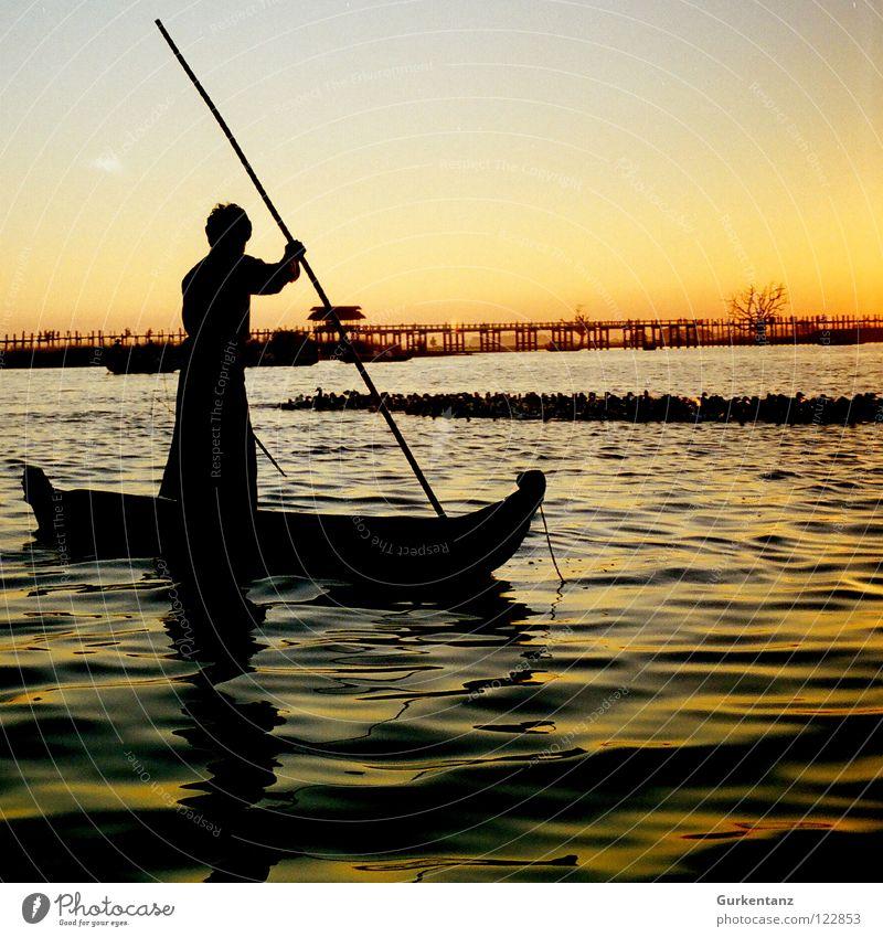Burmese fisherman Myanmar Fisherman Watercraft Lake Sunset Dusk Asia Stick Navigation Bridge Motor barge Gold Shadow Silhouette